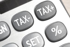 A calculator button showing the text Tax