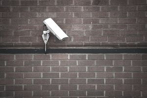 Security camera on brick wall