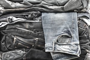 Assortment of jeans packed for the sorting process of recycling