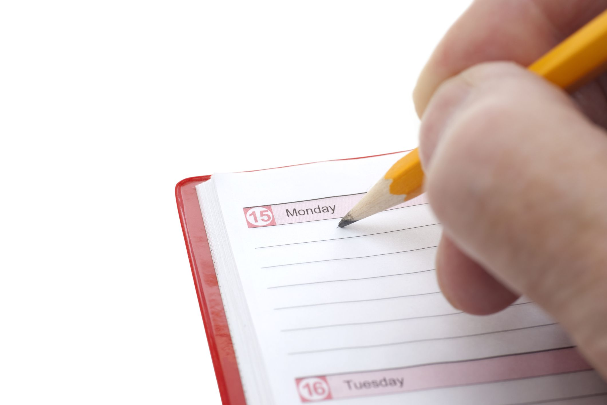 Person getting ready to write in a weekly planner