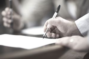 Business person signing a contract