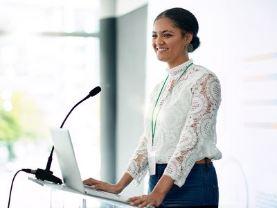 A keynote speaker standing at a podium giving the keynote address.