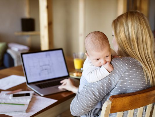 mother with baby using laptop