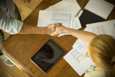 Business associates shaking hands during meeting