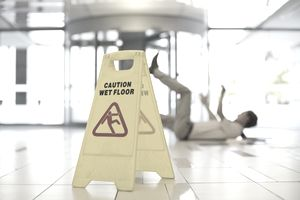 man slipped and fell on wet floor in office building