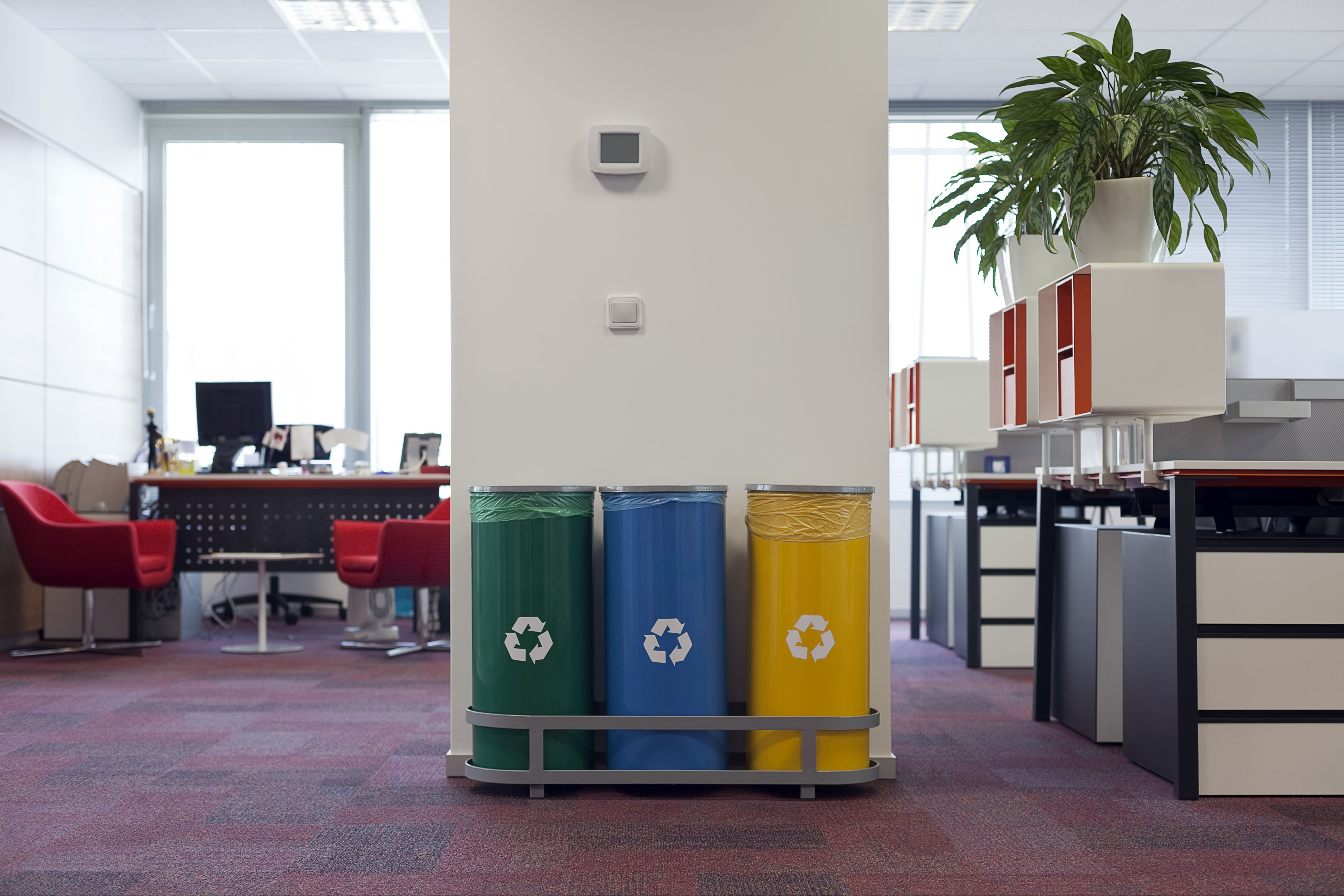Different recycling bins in an office