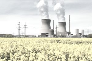 Nuclear Power Plant With Yellow Field and Big Blue Clouds in Germany