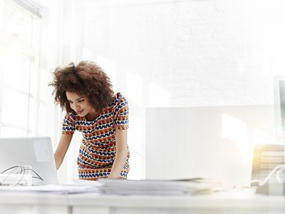Young business woman working on a laptop