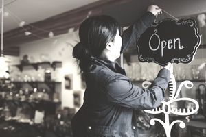 Woman opening up her store