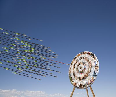 Arrows flying at a target, representing the concept of goal-setting.