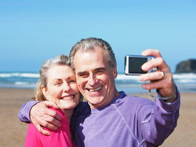 older man and woman on a beach