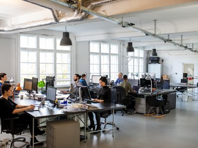 Employees at work in an open plan office