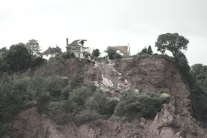 House collapsing on a cliff
