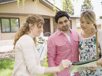Female realtor showing a rental vacancy to a young couple