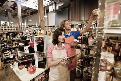 Man and woman checking shelves in specialty grocery