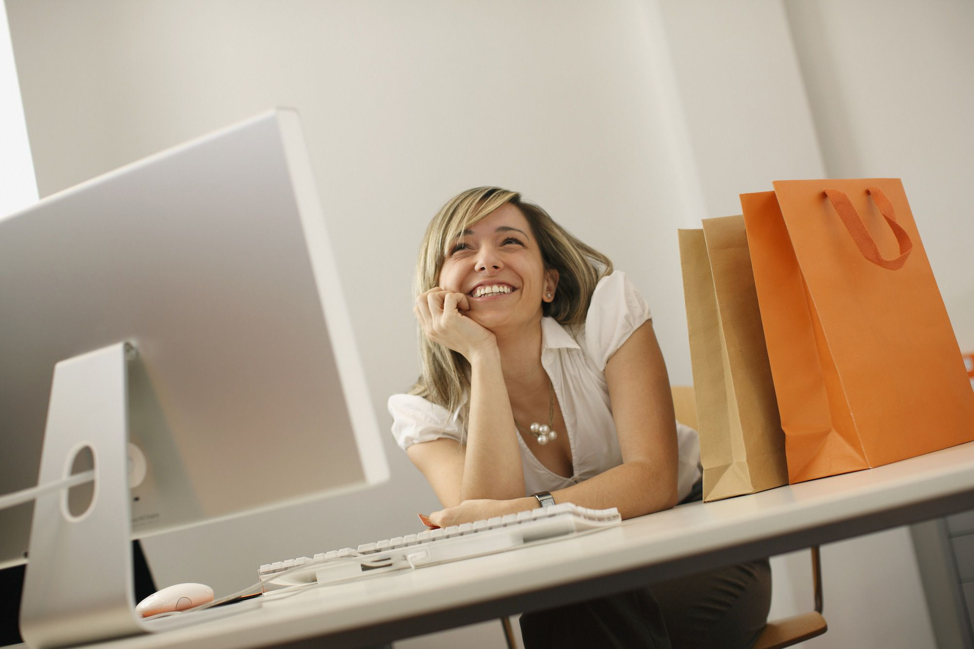 Businesswoman daydreaming at desk