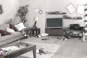 messy living room with damage