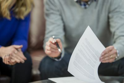 Couple signing legal document