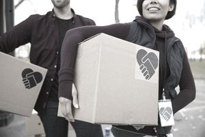 Volunteers carrying boxes of supplies.