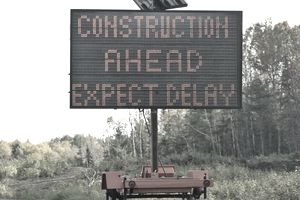 Road Sign Showing Construction Ahead