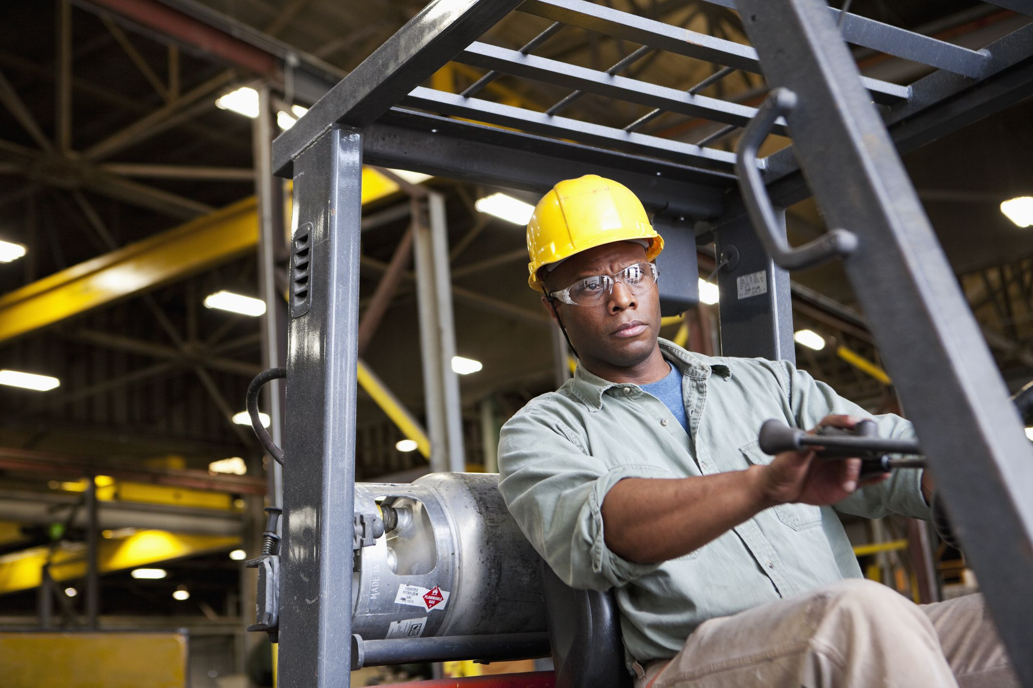 10 Most Violated Osha Standards Worker Making Up Wiring Loom Stock Photo Getty Images
