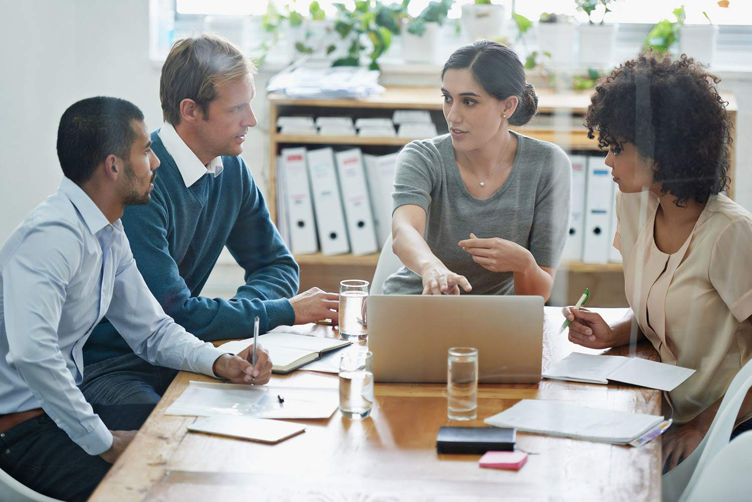 Woman leading a training meeting in an office