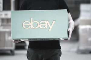 person holding box that says eBay on the side