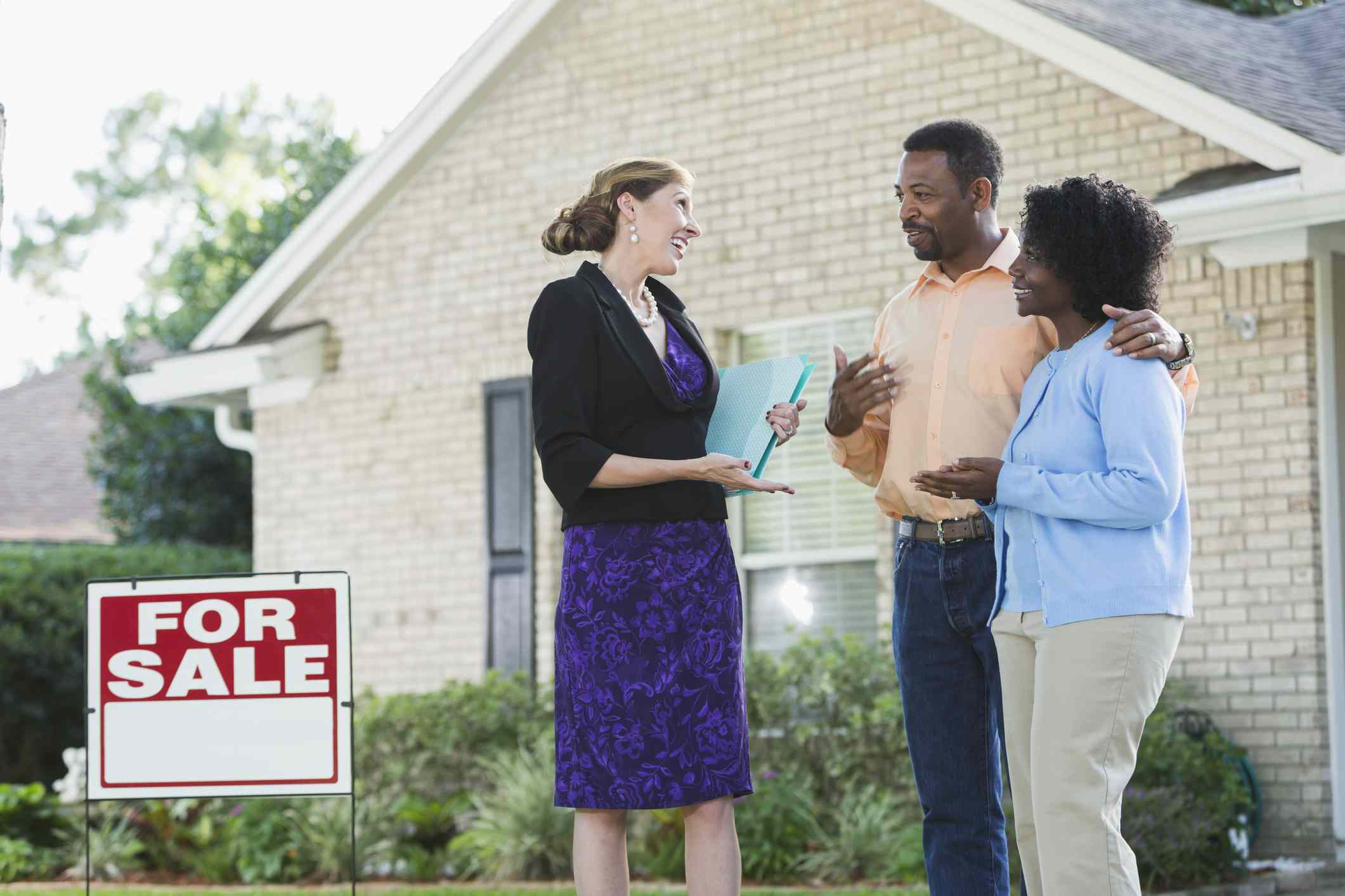 Realtor with marketing and informational materials