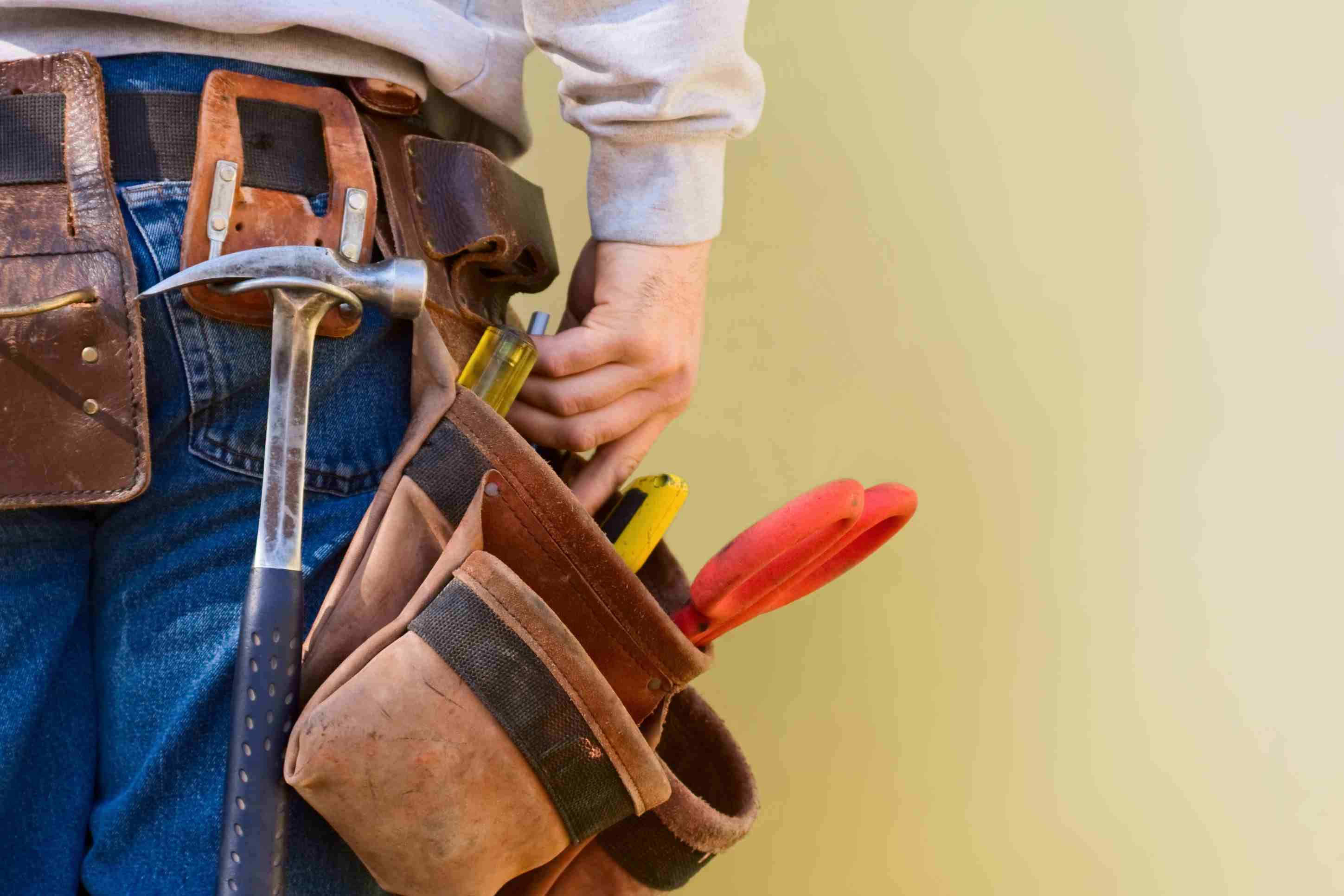 Close-up of a contractor's tool belt full of tools