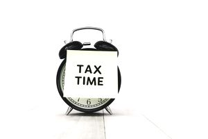 Tax time sticker over clock