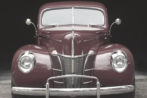 An antique Ford automobile epitomizes the company mission statement of working together.