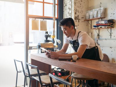Small business owner working in the cafe