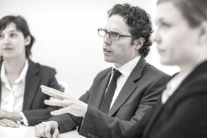 Business colleague discussing plans in meeting