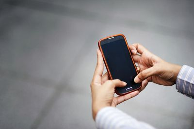 person getting a Short Message Server marketing notice on their smartphone