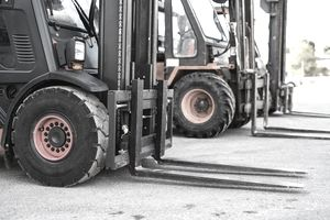 row of forklifts