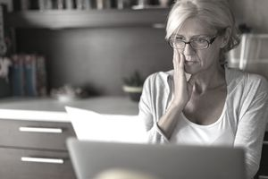 Woman reviewing a Company Financial Report
