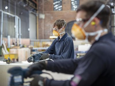Apprentice working on wooden mould in steelworks