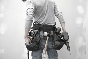 Caucasian man wearing tool belt
