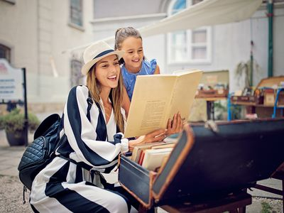 Mother and Daughter Are Choosing Books in a Bookstore