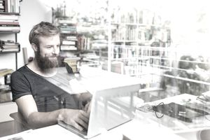 Man working on his eBay store on his laptop