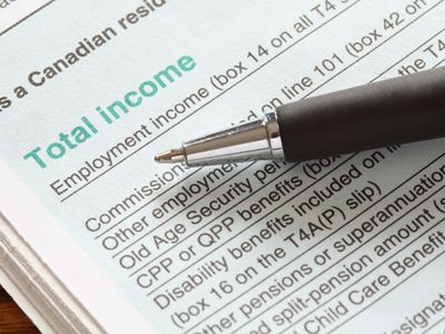 Canadian Income tax return form with a pen laying on top of it