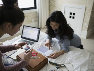 Mother and daughter photographing products to sell on eBay