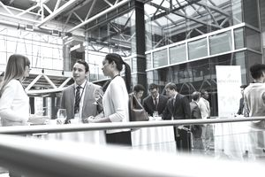 Business people networking at conference on atrium balcony