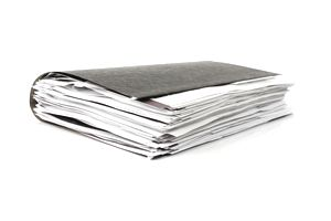 Business folder bulging with documents