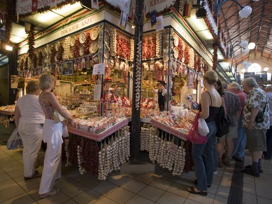 People at a stand for spices, People at a stand for spices in the Central Market Hall, Pest, Budapest, Hungary