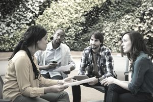 four people having a meeting