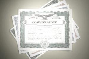 A pile of common stock certificates