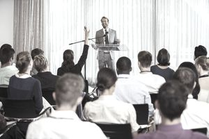 Man speaking at a seminar.
