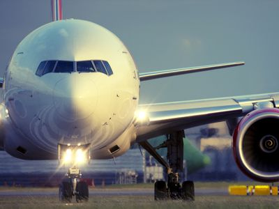 Commercial airplane on runway.