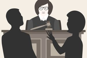 A female judge is listening to two lawyers argue their cases
